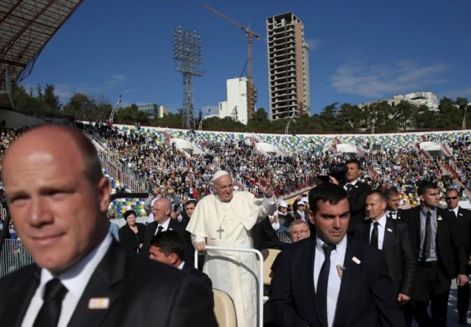 Pope Francis waves as he arrives to lead the Holy Mass at the Mikheil Meskhi Stadium in Tbilisi