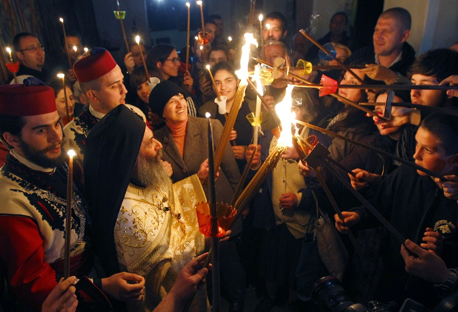 Priests lead the Christian Orthodox Easter service at the 10th century St. John the Baptist Monastery